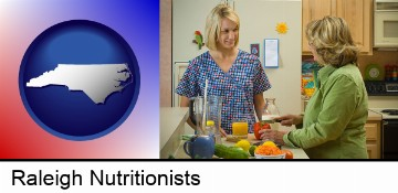 a nutritionist discussing food choices with client in Raleigh, NC
