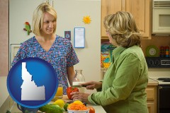 idaho map icon and a nutritionist discussing food choices with client