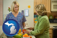 michigan map icon and a nutritionist discussing food choices with client
