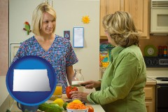 north-dakota map icon and a nutritionist discussing food choices with client