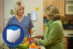 ohio map icon and a nutritionist discussing food choices with client