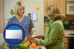 south-dakota map icon and a nutritionist discussing food choices with client