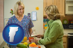 vermont map icon and a nutritionist discussing food choices with client