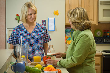 a nutritionist discussing food choices with client