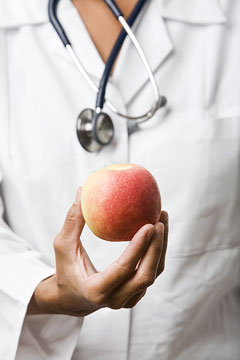 a nutritionist holding a nutritious apple